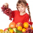 Child eating vegetable and fruit. — Stockfoto