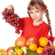 Child eating vegetable and fruit. — Стоковое фото
