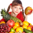 Child eating vegetable and fruit. - Stock Photo