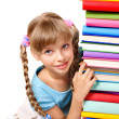Schoolgirl holding pile of books. — Stock Photo #6336794