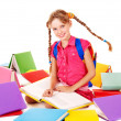 School girl holding pile of books. — Stock Photo