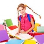 School girl holding pile of books. — Stock Photo