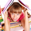 Child reading open book on table. — Stock Photo #6336812