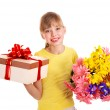 Child holding gift box and flowers. — Stock Photo #6336824