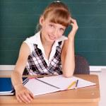Schoolchild in classroom near blackboard. — Stock Photo #6336850
