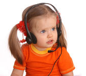 Portrait of child with headset. White background. — Stock Photo