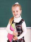 Schoolchild near blackboard. — Stock Photo