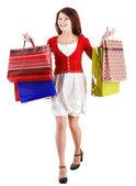Dívka drží skupiny nákupní taška. — Stock fotografie