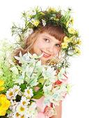 Beautiful girl with garland of wild flower. — Stock Photo