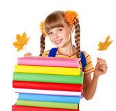 Girl holding pile of books. — Stock Photo