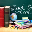 Books and blackboard. School supplies. — Stock Photo #6380464