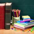 Books and blackboard. School supplies. — Stock Photo #6380465