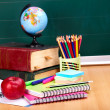 Books and blackboard. School supplies. — Stock Photo #6380467
