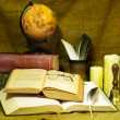 Stack old book and candle. — Stock Photo