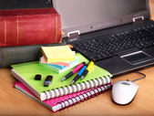 Books and laptop. School supplies. — Stockfoto