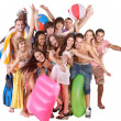 Group holding beach accessories. — Stock Photo #6405501