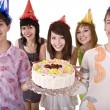 Royalty-Free Stock Photo: Group of teenagers celebrate happy  birthday.
