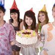 Stock Photo: Group of teenagers celebrate happy birthday.