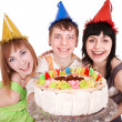 Group of happy young with cake. — Stock Photo #6409484