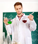 Man chemistry student with flask. — Stock Photo