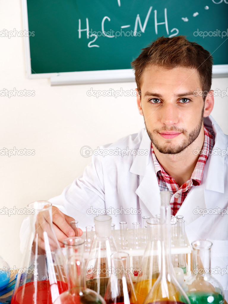 Man chemistry student with flask in classroom. — Stock Photo #6408407