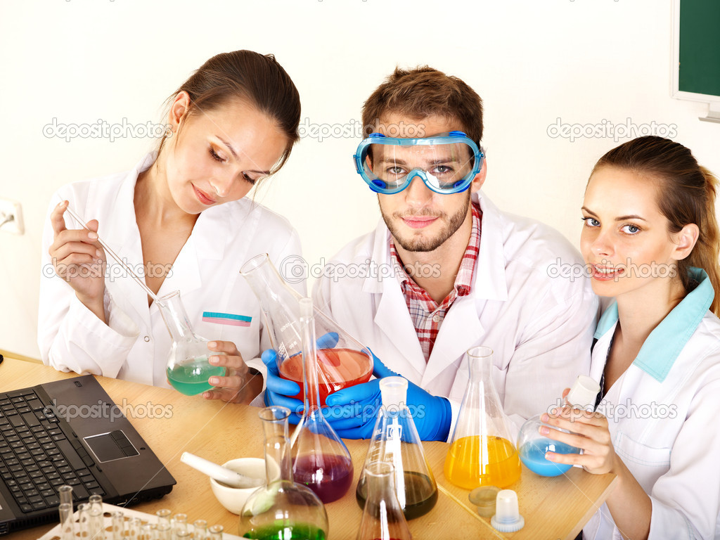 Group chemistry student with flask in classroom. — Stock Photo #6408410