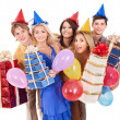 Group of young in party hat holding gift box. — Стоковое фото