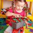 Child plaing block and construction set in preschool. — Stock Photo #6723873