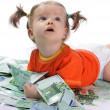 Baby and euro. — Stock Photo