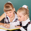 Schoolchildren in classroom near blackboard. - Foto Stock