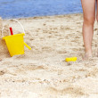 Child leg in sand. — Stock Photo
