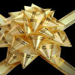 Stock Photo: Gold bow and ribbon. Isolated.