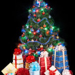 Christmas tree with stack of gift box. - Stock Photo