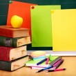 Books and blackboard. School supplies. — Stock Photo