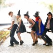 Stock Photo: Group of in witck hat on broomstick.