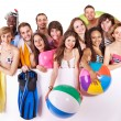 Stock Photo: Group holding beach accessories.