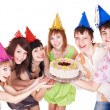 Group in party hat eat cake. - Foto Stock