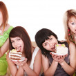 Group of young woman eating cake. - Foto Stock