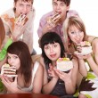 Group of  young with cake. - Stock Photo
