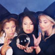 Stock Photo: Young womwith crystal ball. Fortune Telling.