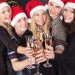 Group young in santa hat at nightclub. — Stock Photo #6724895