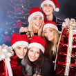 Group in santa hat holding stack gift box. — Stock Photo #6724906