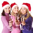 Girls in santa hat drinking champagne — Stock Photo #6724946