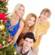 Group near christmas tree. — Stock Photo