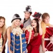 Group in santa hat holding stack gift box. — Foto de Stock