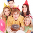 Group holding cake. — Foto de Stock