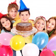 Group holding cake. - Stock Photo