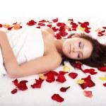 Beautiful girl in rose petal. — Stock Photo #6725164