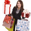 Girl in business suit with group  gift box and  bag. — Stockfoto