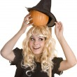 Halloween witch in black hat with pumpkin on broom. — Stock Photo #6725214
